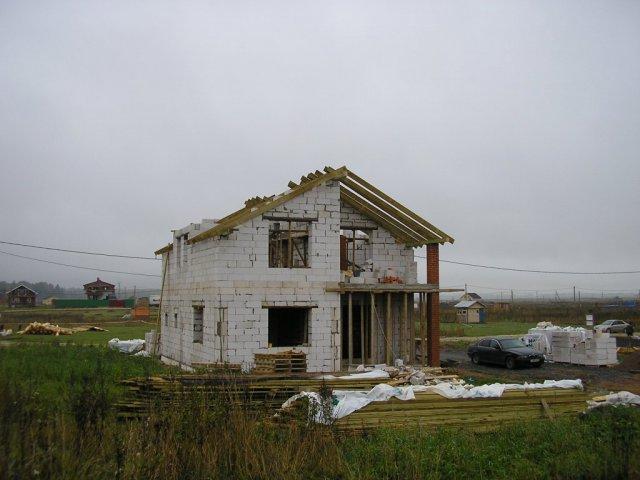 Вид дома с участка